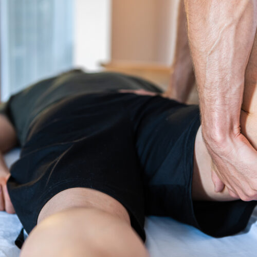 A,Middle-aged,Male,Getting,A,Relaxing,Leg,Massage,After,Hard